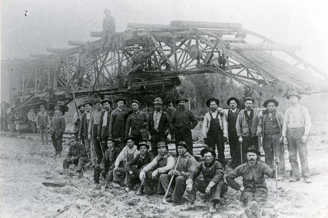 Historical photo of the men who were referred to as Track Layers who worked on the Manistee and Northeaster Rail Road in Manistee