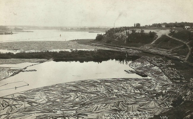Historical photoing showing logs that had been floated down the rivers to Manistee Lake for processing at the Lumber Mills alroundManistee Lake