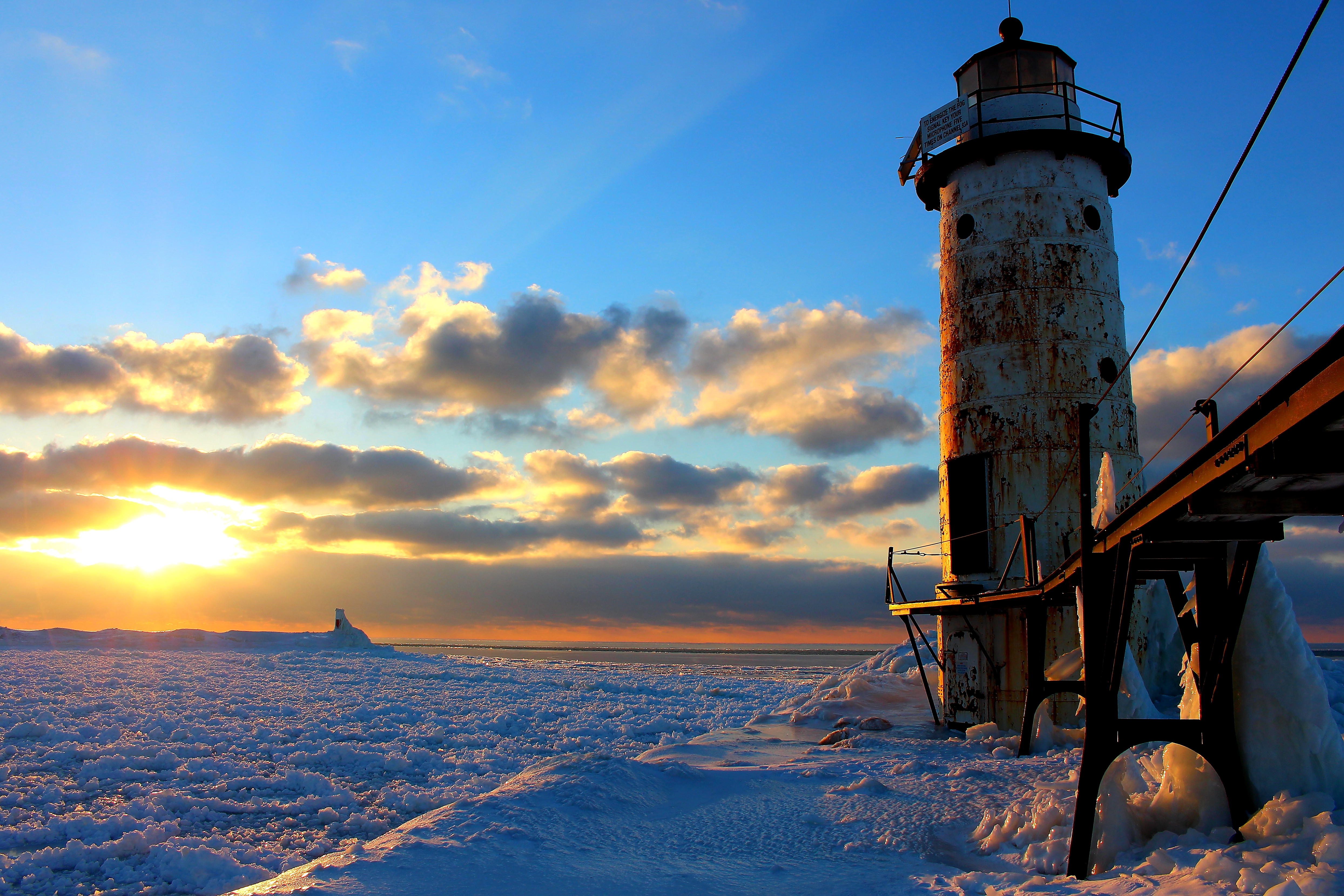 A beautiful winter day at Fifth Avenue Lighthouse with snow and ice