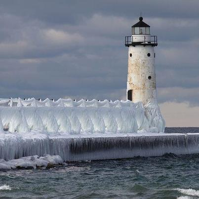 Catwalk encased in ice with the Fifth Avenue Lighthouse on a winters day in 2013