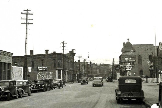 Photo taken circa 1938 looking west on River Street near the intersection of Division and River Street cars are parked along both sides of the street