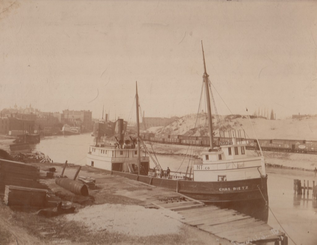 Historical photo of a ship  docked on the south shore of the Manistee River Channel