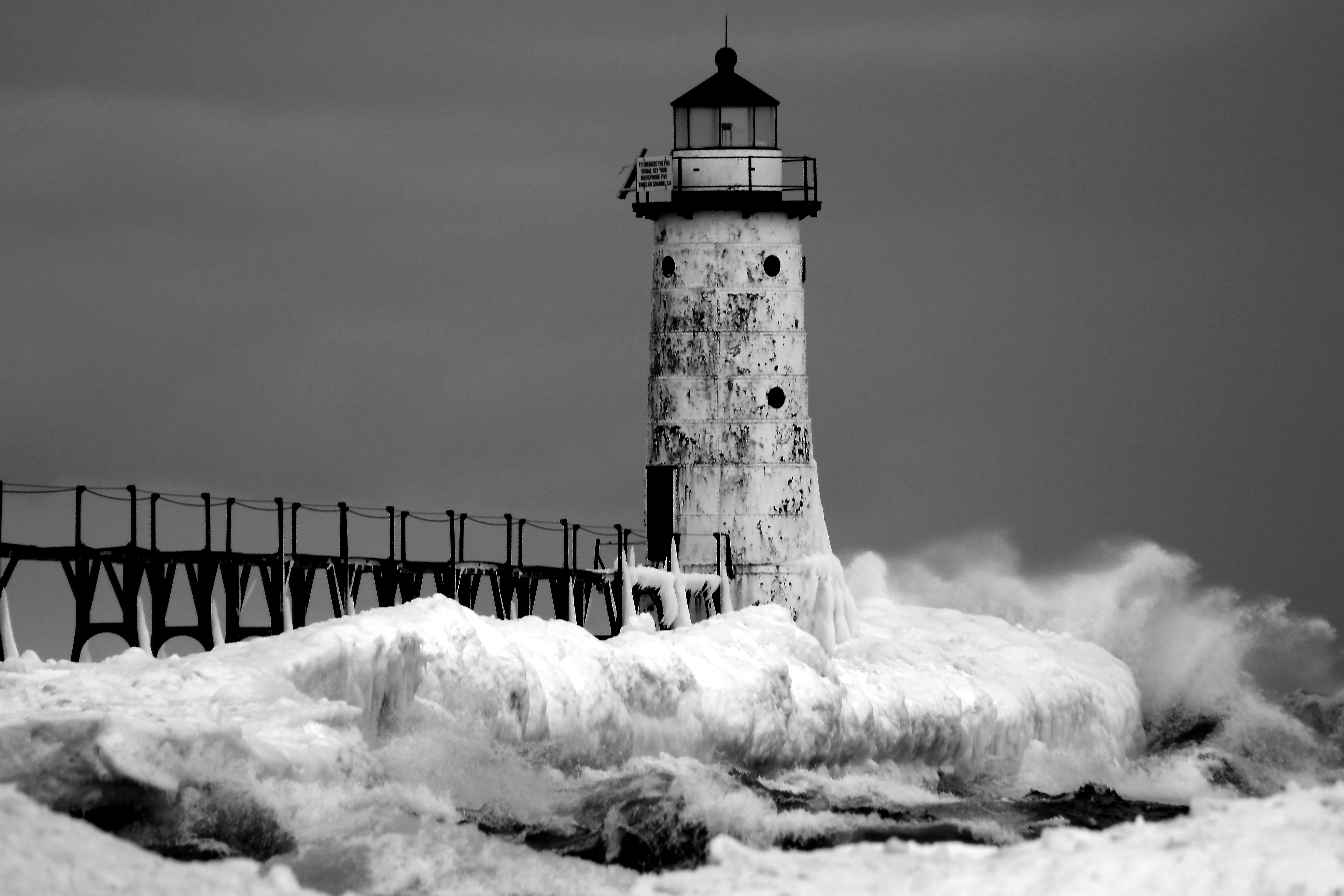 Black and white photo showing winter ice at Fifth Avenue Lighthouse